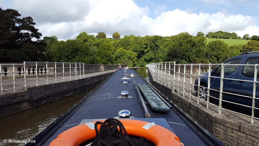 Cruising round a 90 degree bend in a longboat on a narrow canal