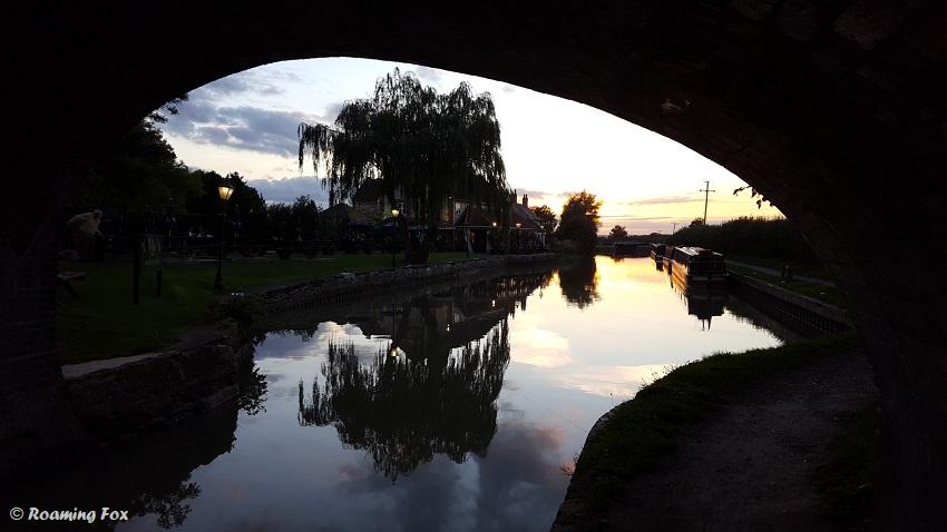 Sunset-reflections-under-bridge-canal