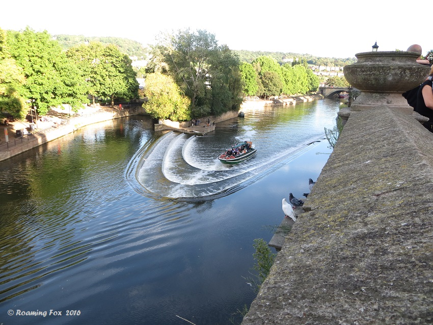 Weir and boat in Bath viewed from side