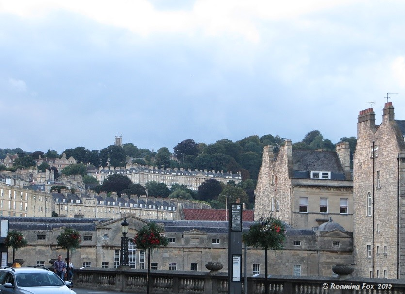 Rows of buildings made from golden stone in Bath
