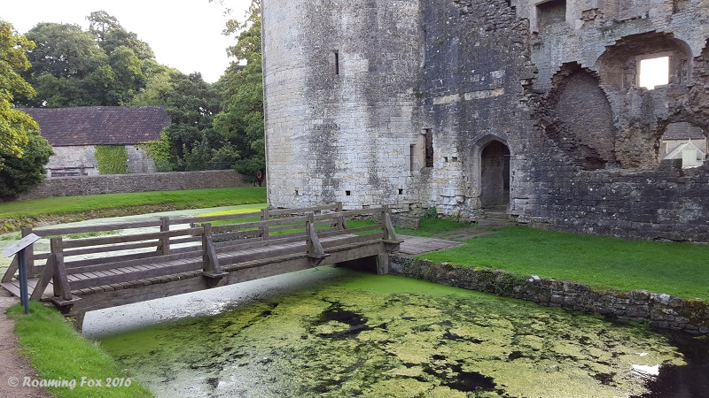 Ruins of Nunney castle and bridge over moat