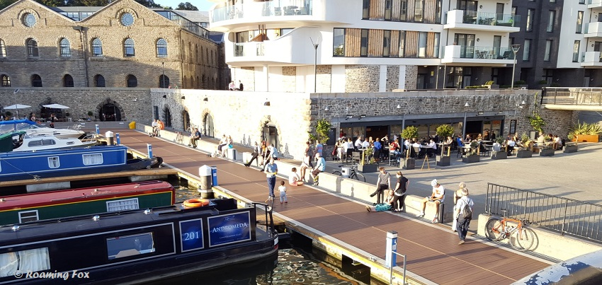 Harbour inlet with canal boats, people and Millenium Promenade