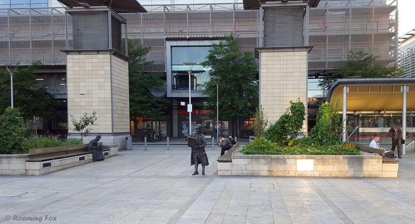 Three of the four statues - William Tyndale sitting, William Penn standing and Cary Grant to the right, standing