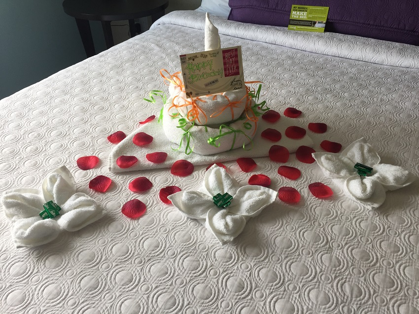 Towel Art cake and flowers Checking it off the list Birthday