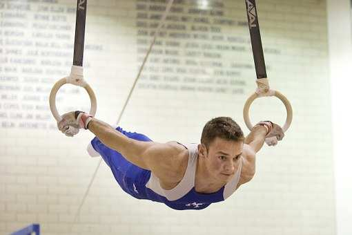 Olympic level gymnasts used wooden rings exclusively