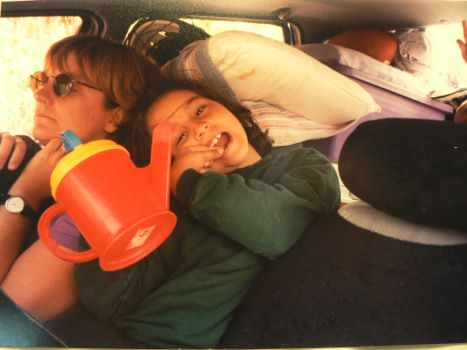 Nancy and her kids in their car, packed up for camping!