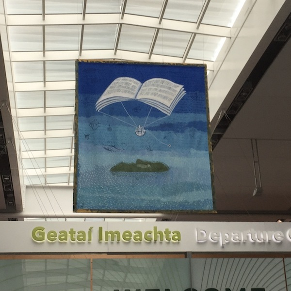 The Peter Sis-designed tapestry, dedicated to Seamus Heaney and featuring lines of his poetry,that hangs in Dublin Airport.