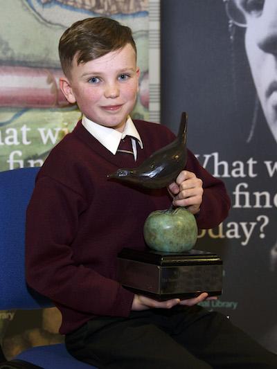 Last year's Junior Category Winner Brendan Mac Domhnaill of Coláiste Oiriall, Co. Monaghan, with the Poetry Aloud trophy.