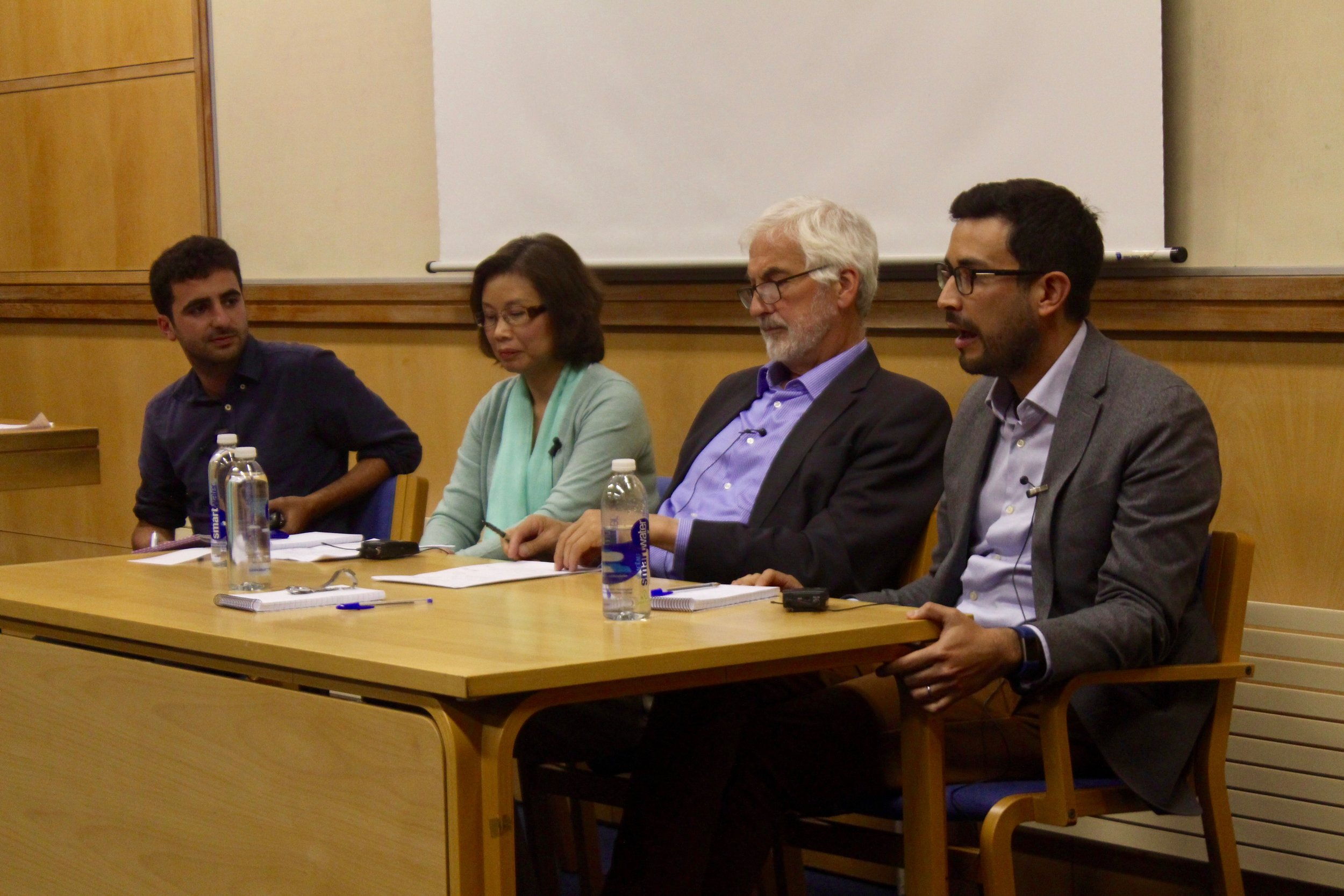Pictured (from left to right): Michael Blake, Xiaolan Fu, Tony Venables, and Alejandro Riaño