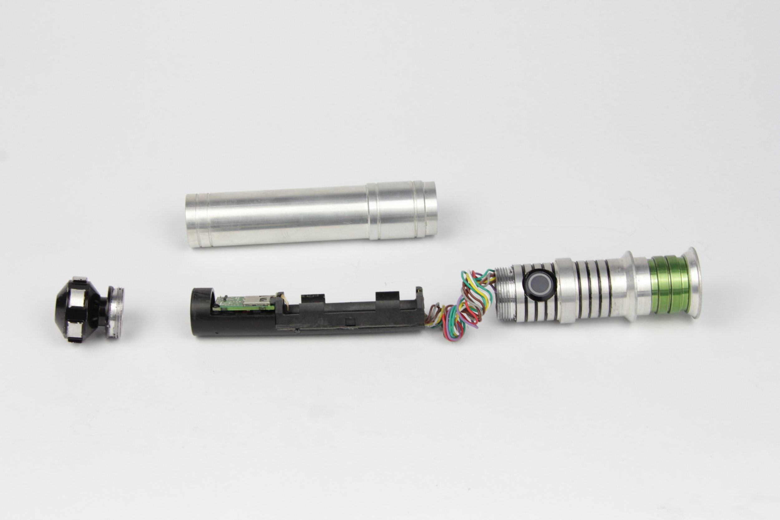 Fully opened saber, notice tightly wound wiring that is exposed when changing the battery