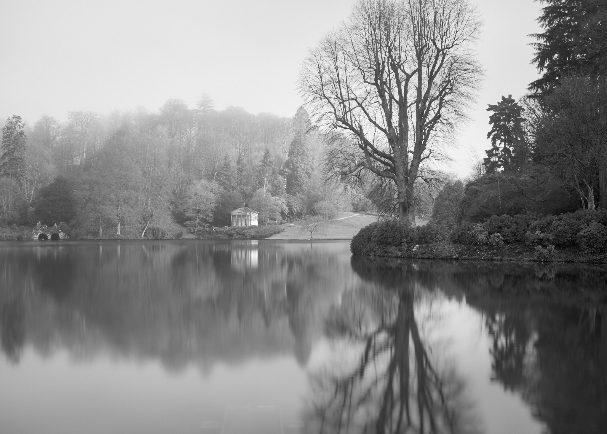 Quiet reflection of the Temple of Flora, at Stourhead Gardens, in Wiltshire.