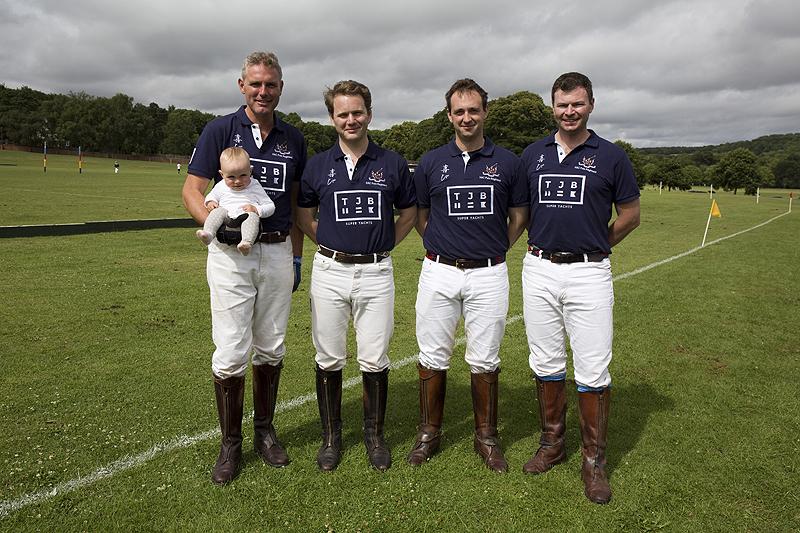 The TJB HAC Polo (Regimental) Team and polo ball sized fan on a rare sunny moment.
