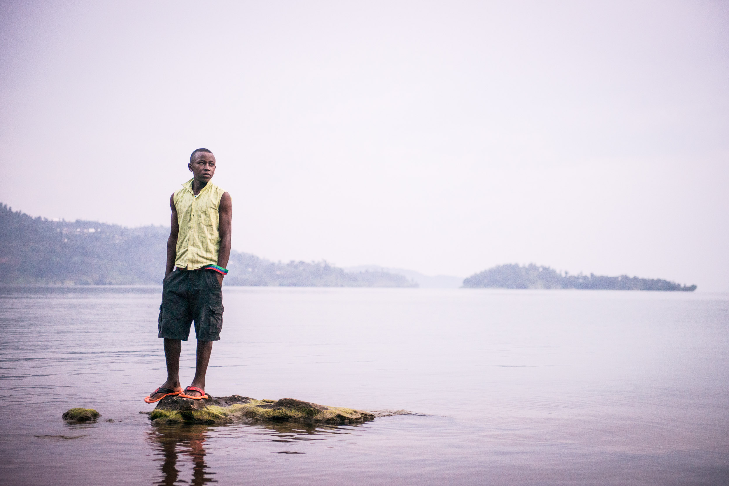 Rwanda boy on lake - Travel - Photo credit Nicola Bailey.jpg