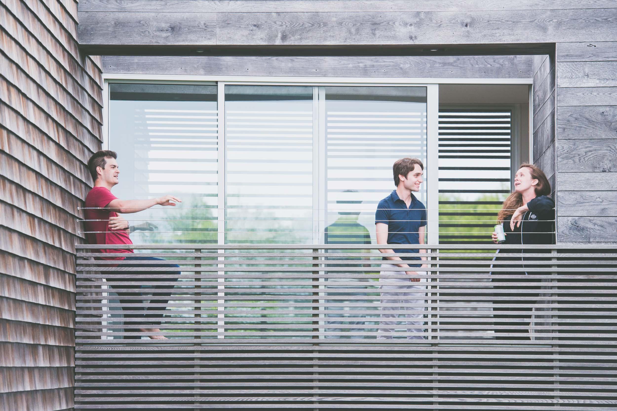 Talking on balcony - Lifestyle - Photo credit Nicola Bailey.jpg
