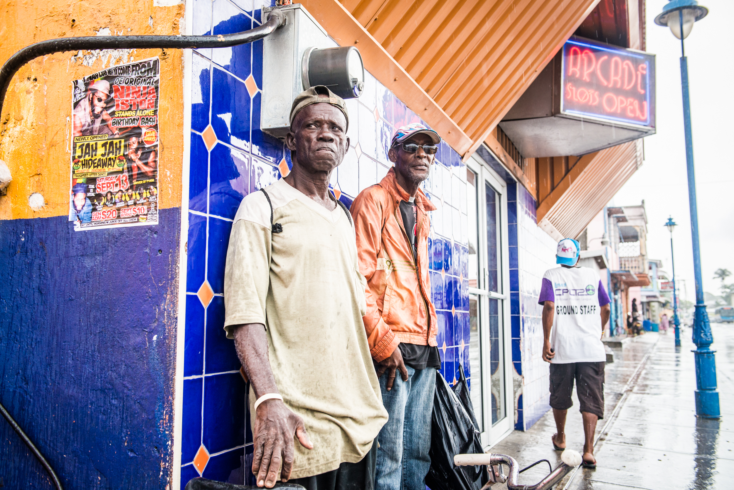 Men outside arcade in Barbados - Travel - photo credit Nicola Bailey.jpg