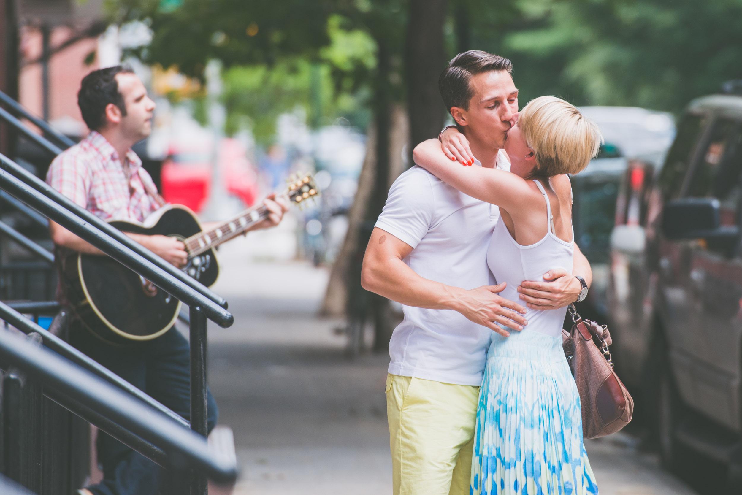 Couple kissing near guitar player - Engagement Portraits - Photo credit Nicola Bailey.jpg