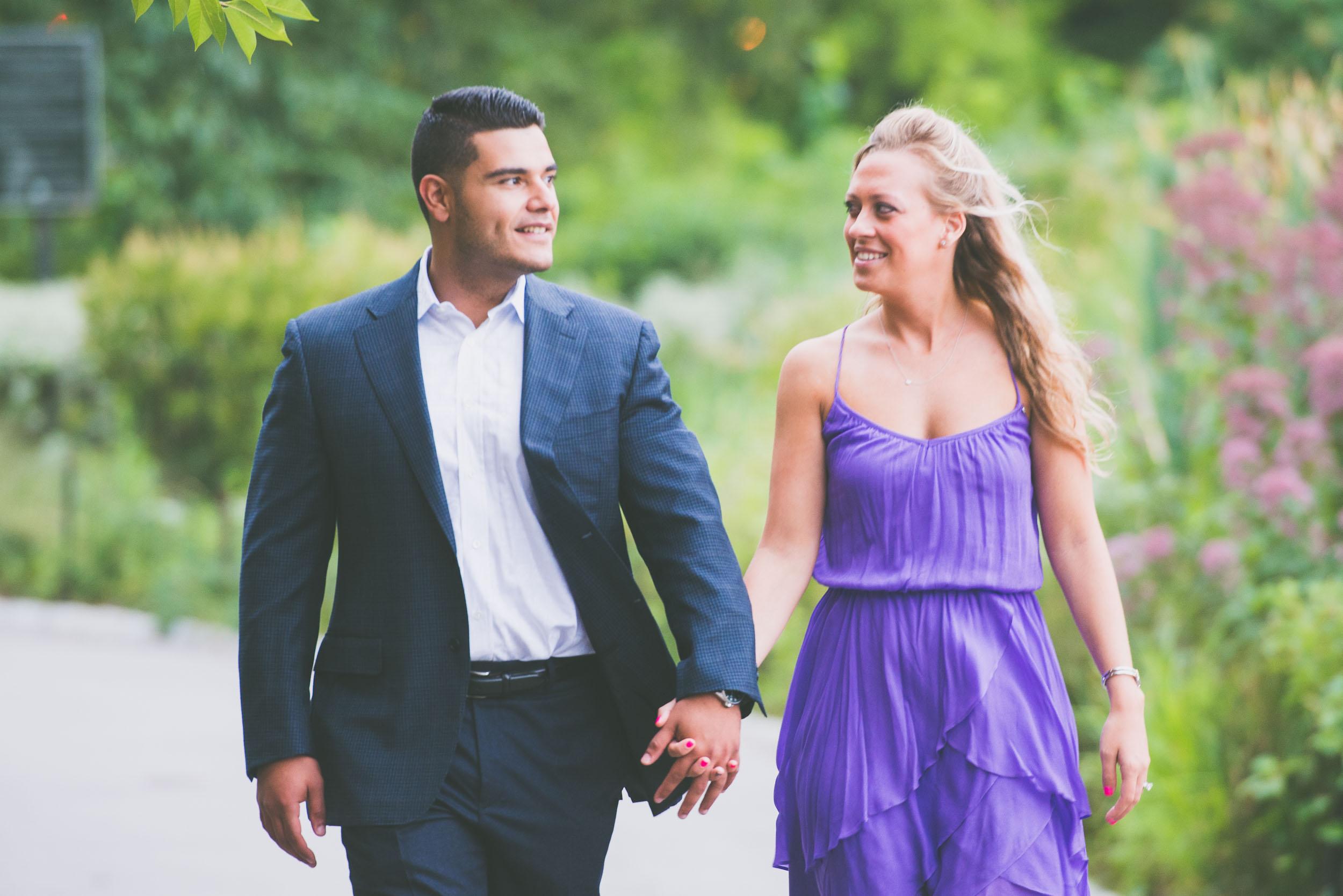 Couple walking through gardens - Engagement Portraits - Photo credit Nicola Bailey.jpg