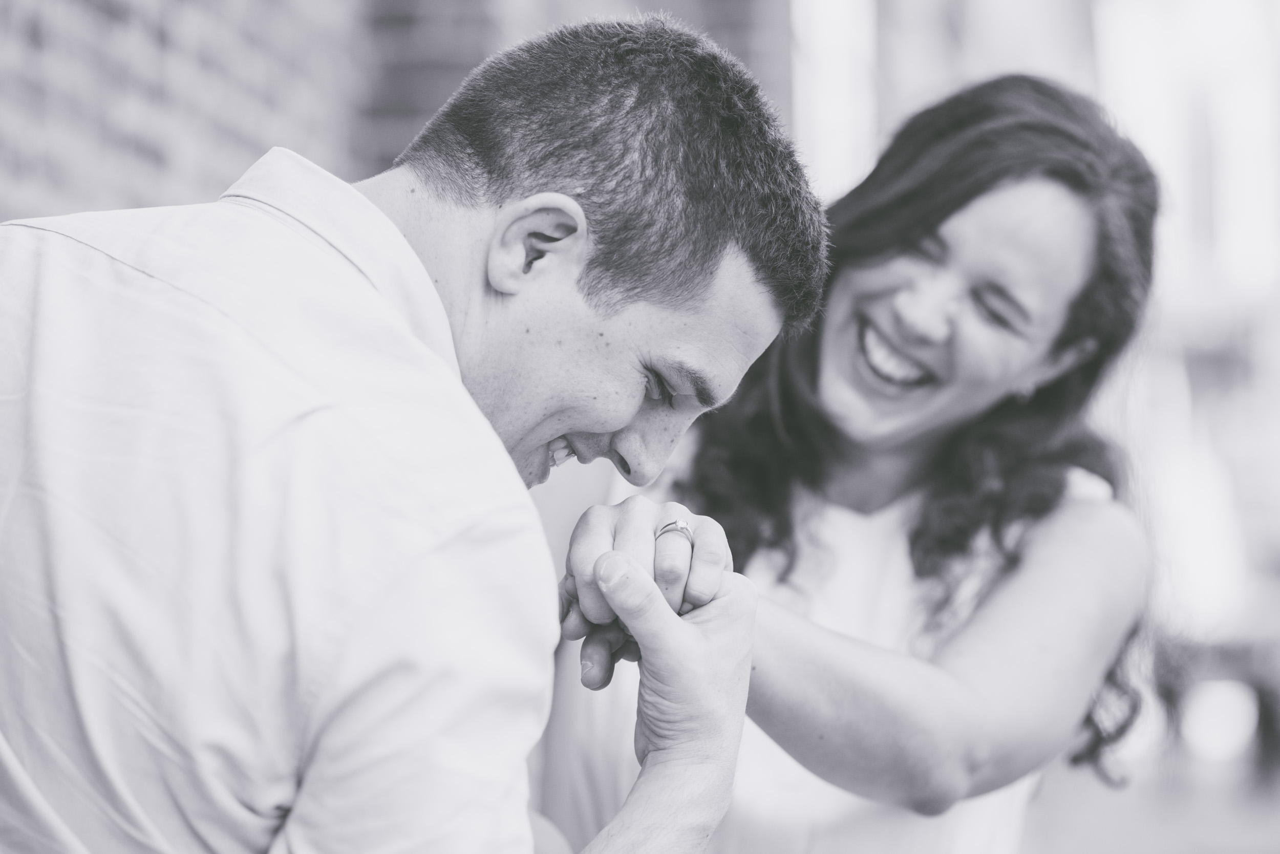 Laughing looking at ring - Engagement Portraits - Photo credit Nicola Bailey.jpg