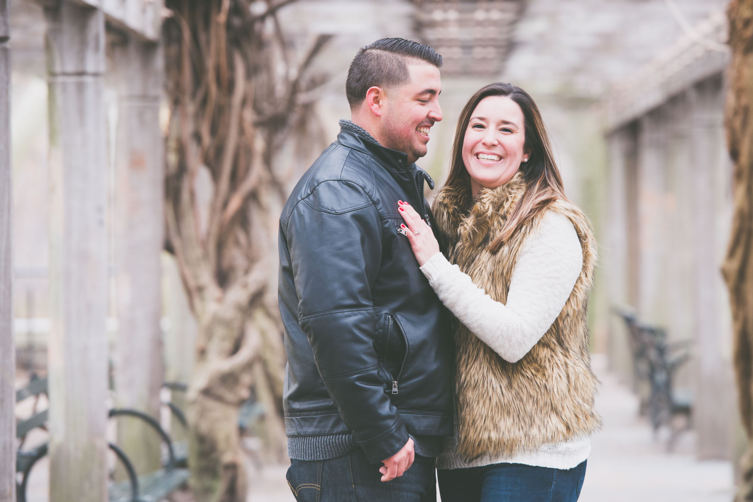 Laughing under wooden beams in Central Park - Engagement Portraits - Photo credit Nicola Bailey.jpg
