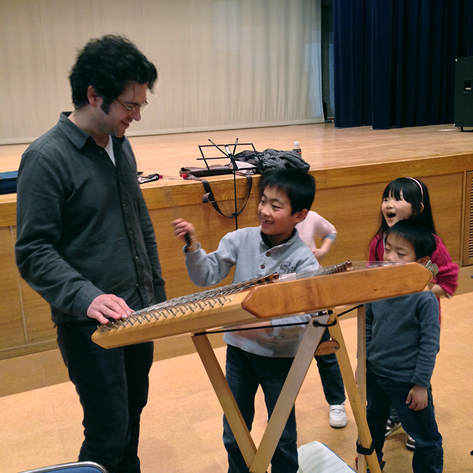 Percussionist Nathan Davis introduces students to the prepared hammered dulcimer.
