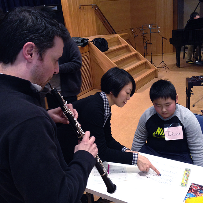 Oboist Nick Masterson performs a work in progress by Tokuma-chan, an El Sistema Composition student.