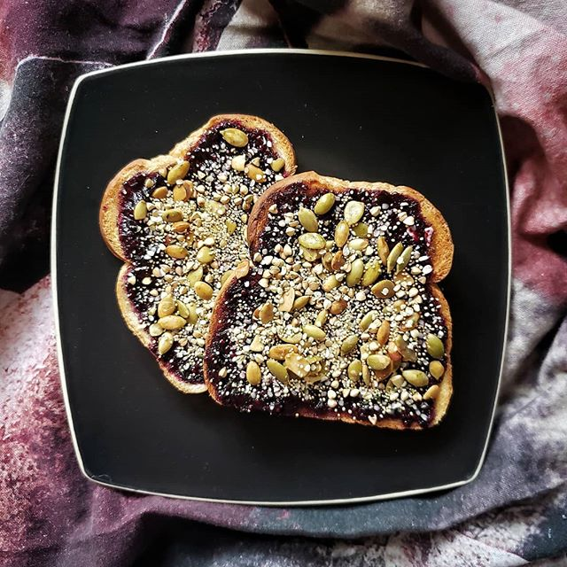 Snack attack never looked so good! Buttered toast with chia jam, pepitas, hemp, buckwheat groats, and amaranth. 😍