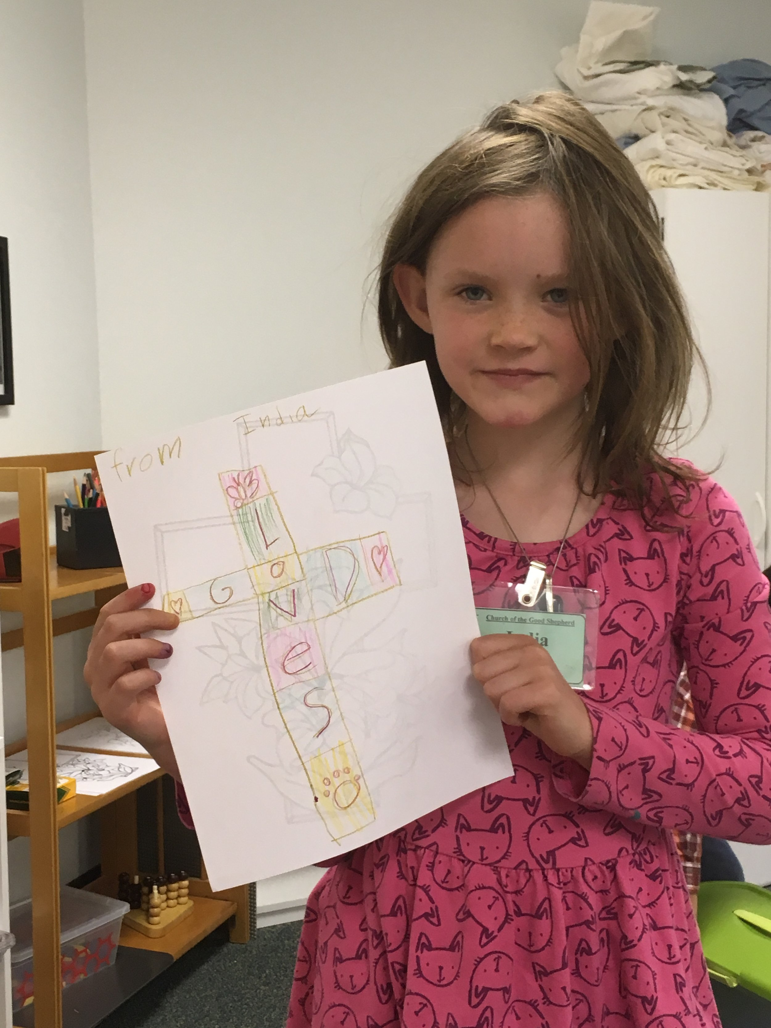 Godly Play student, India, shows off her artwork