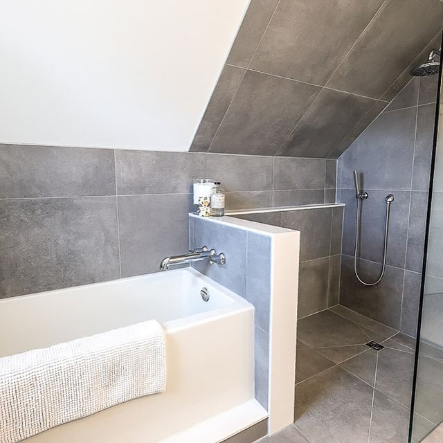 Spa oasis anyone? A recently completed bathroom renovation with a boutique hotel feel! Our favourite feature.... heated floors throughout....even in the shower and the modern faucets and fixtures ❤️ 🔨@vertical_construction_group 📸@stevenwarrenphotography  #luxurybathroom #gtarealestate #torontorealestate #hotelinspired #stagedtosell #stagingworks #stagingtoronto #hireaprofessional  @styledinteriors #hireadesigner #hireadecorator #modernesthetics #luxuryhome #investinyourhome #megatransformation #torontorenovations #torontocontractor