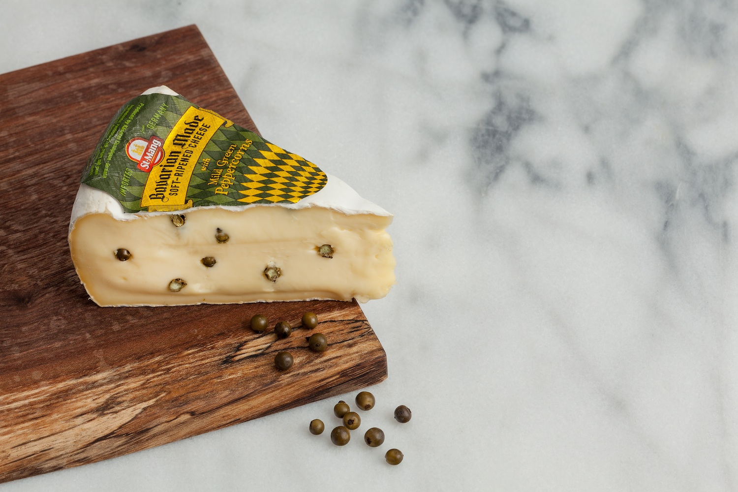 Mild Green Peppercorns -  A double-cream soft-ripened cheese with whole green peppercorns.Velvety and smooth texture, with a warm and spicy undertone of pepper.2014 World Cheese Awards Bronze winner.