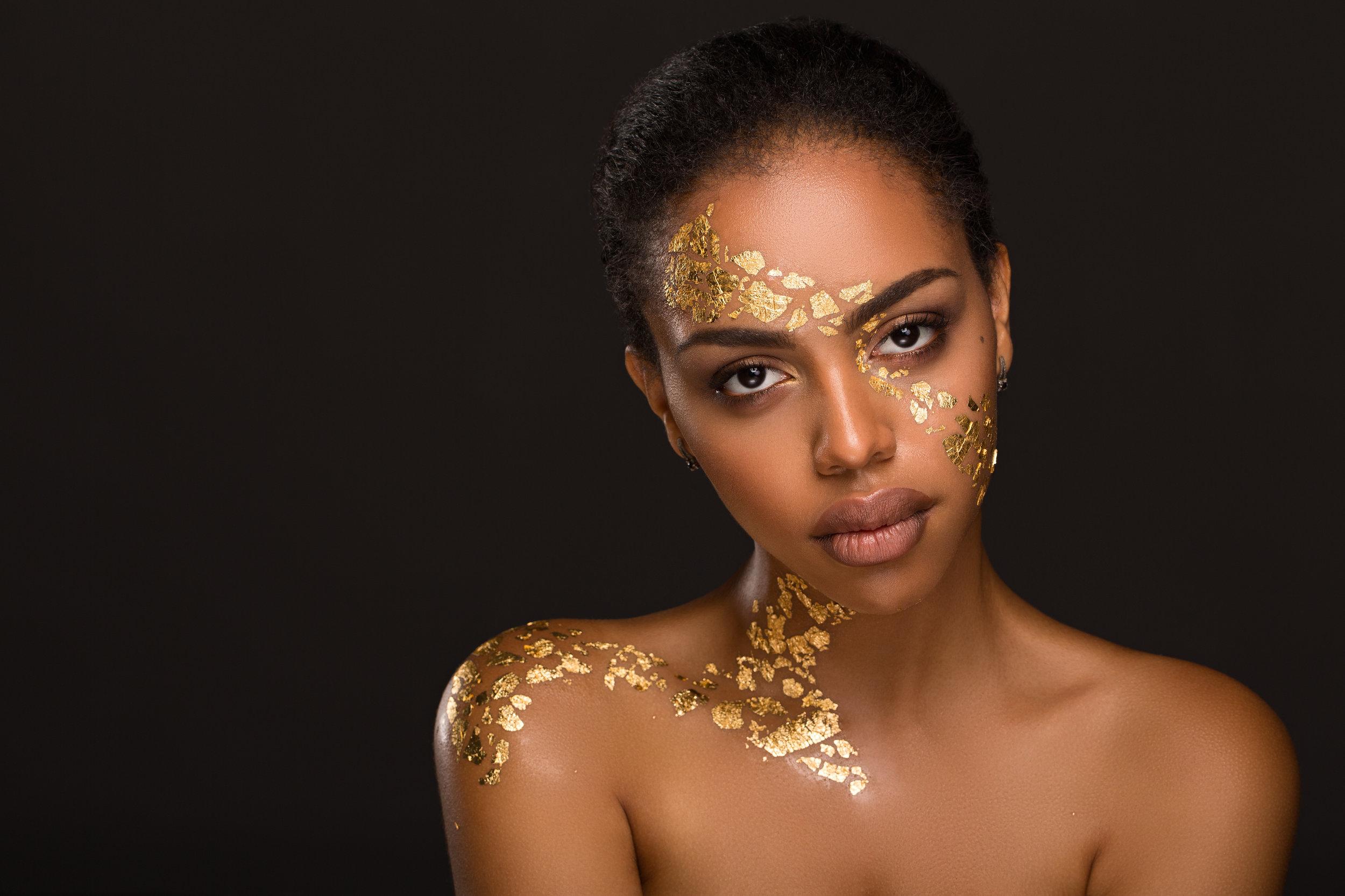 Beautiful young black woman with makeup