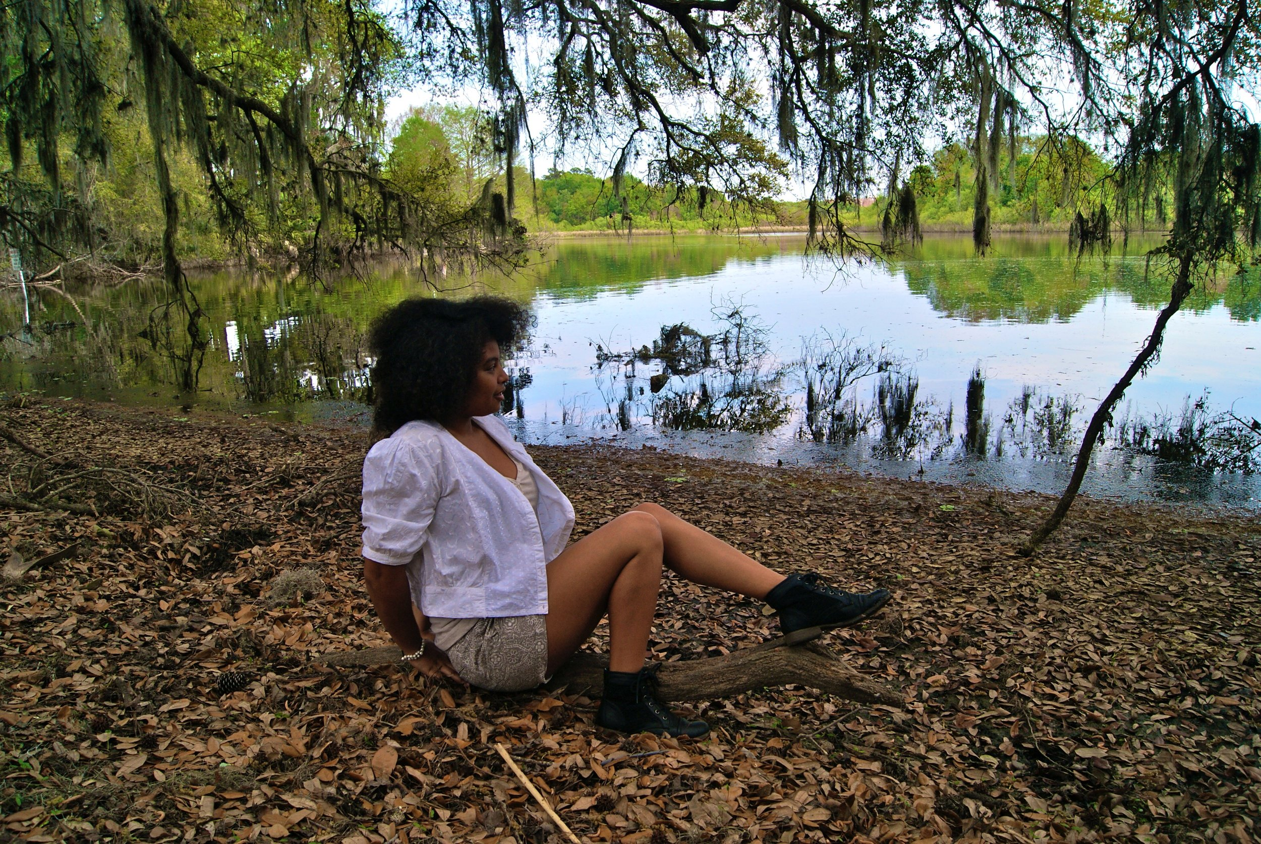 I was sitting on a bark of wood in Lake Alice, which was located at the University of Florida.