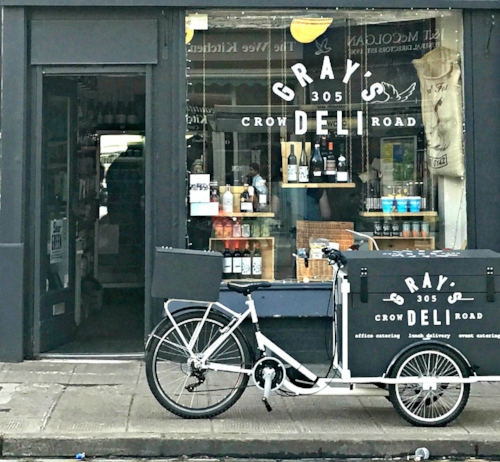 grays deli cargo bike outside shop