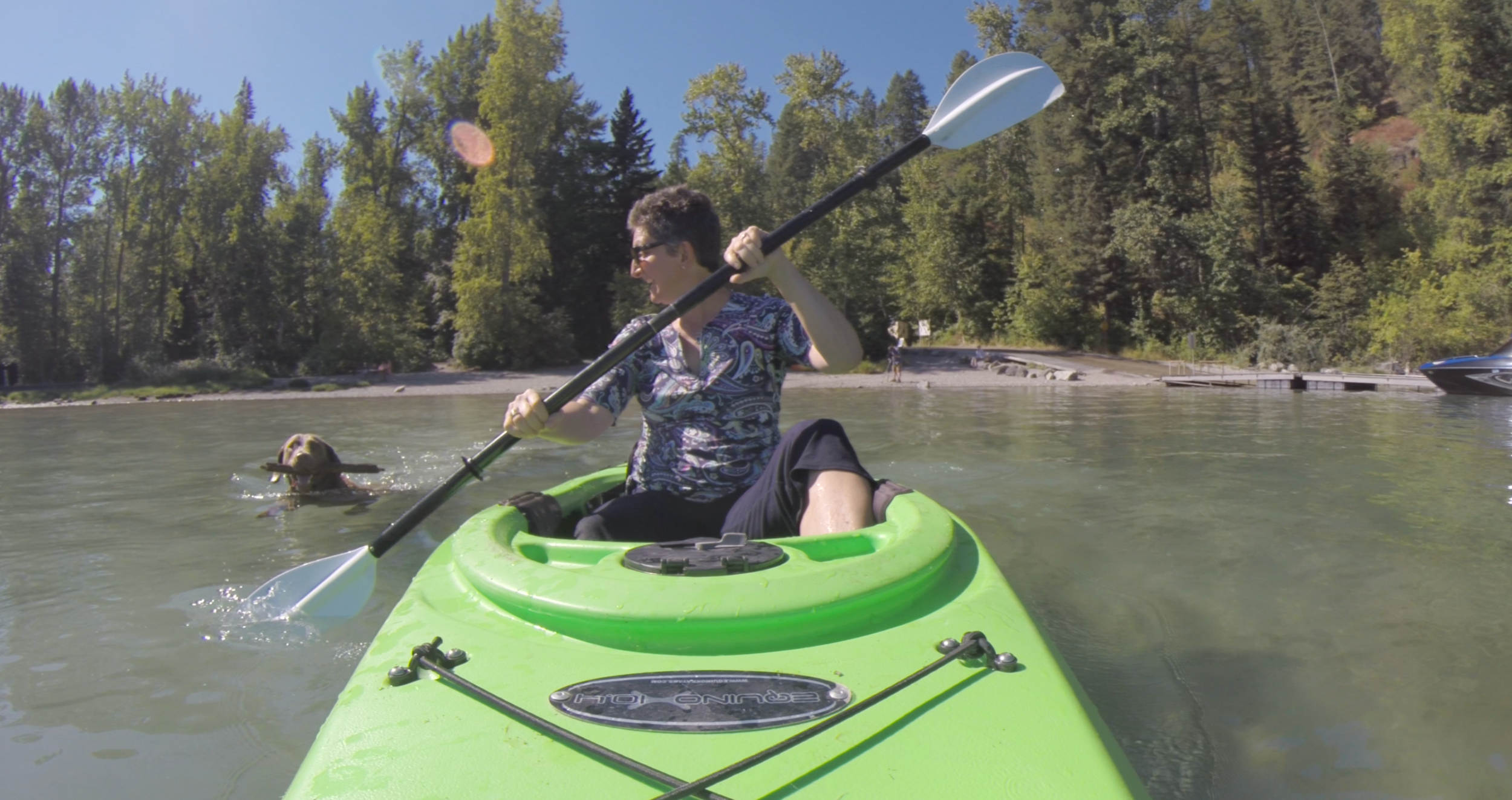 francine roston, rabbi of the flathead valley, kayaks on whitefish Lake in montana.