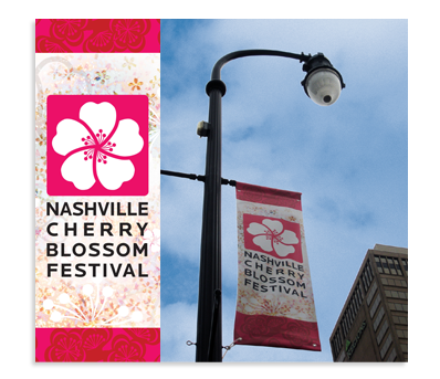 Pole banners help attendees find the Nashville Cherry Blossom Festival in all the rush of downtown activity, especially if they don't take advantage of the easy and inexpensive shuttle.