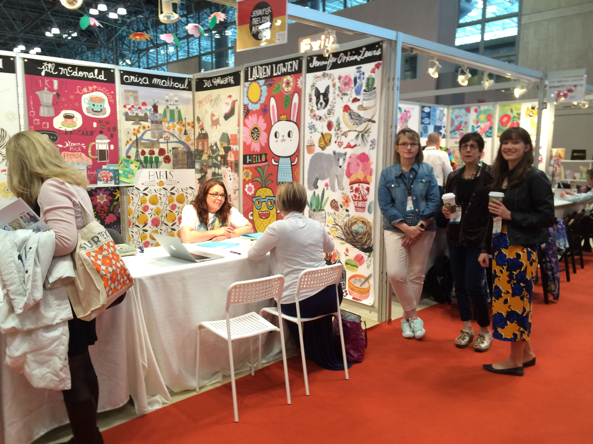 Jennifer Nelson Artists' booth stands out as a wonderful example of great booth design and representing great artists like Lauren Lowen, Jennifer Orkin Lewis (aka August Wren), Jill Howarth, Anisa Makhoul, Jill McDonald, Bee Brown, and Jessica Swift.