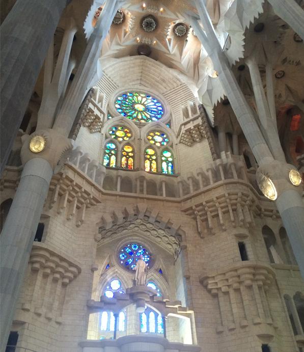 IMAGE: Interior view of La Sagrada Familia combining Gothic and Art Nouveau forms.