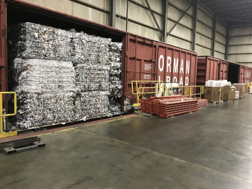 Recently, I joined this design group on a tour of a printing facility that recycles so much of their waste, train tracks lead into and out of their warehouse to cart it all away. This is just one of the many practices they implement in order to reduce their environmental impact.