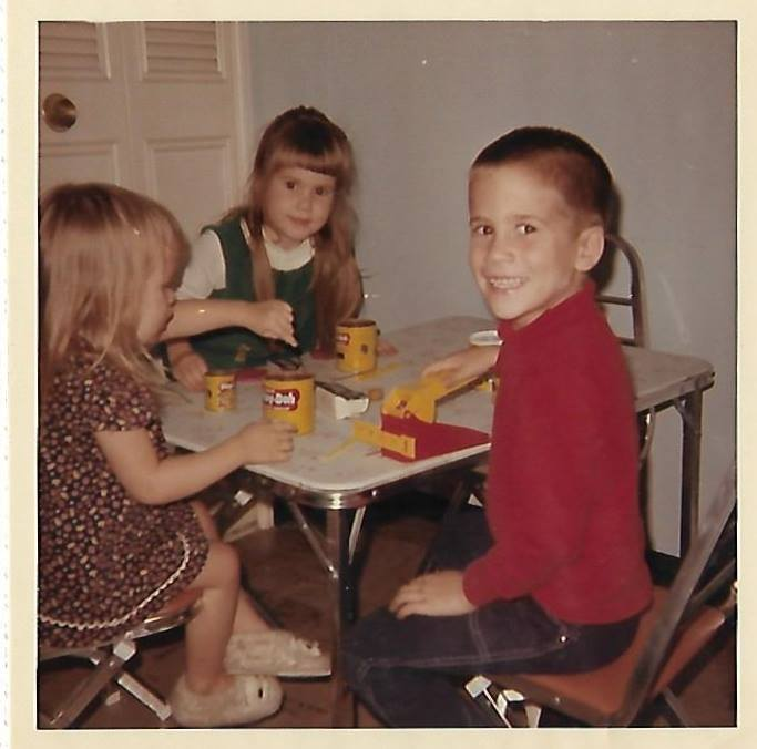 My siblings and me playing with the ever entertaining Play Doh—focus so strong I couldn't be bothered with looking at the camera!