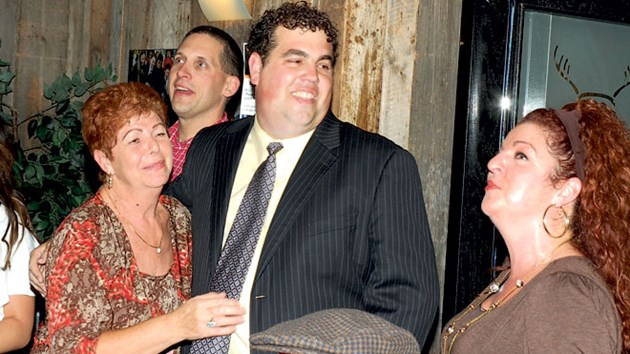 With his arm around his mother, Franca, while he smiles at his sister, Sabrina Cimino, Ward 8 Coun. Fabio Belli celebrates his election win in 2010. The 37-year-old popular city councillor died suddenly in Florida on April 12 from an apparent heart attack. File photo.