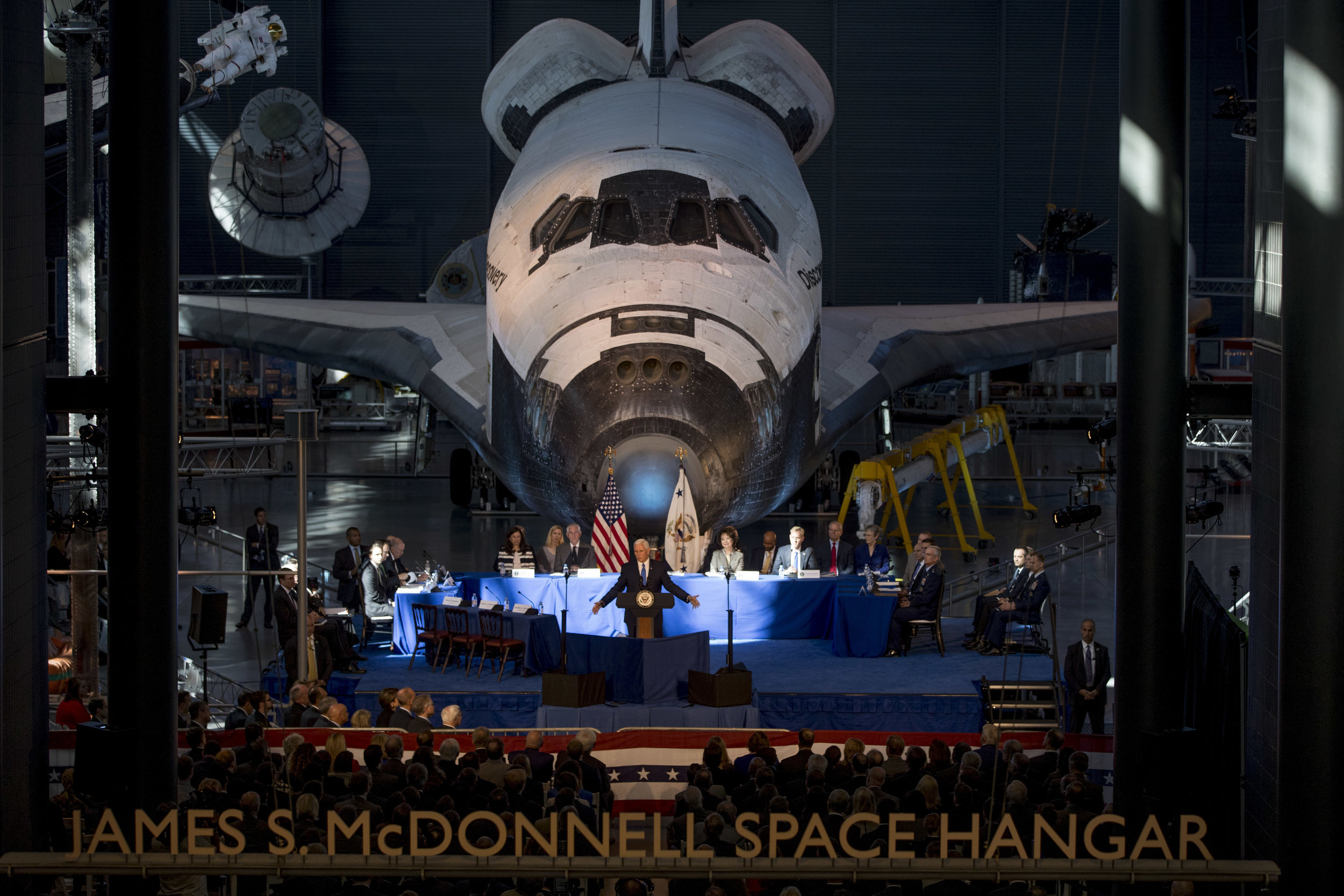Vice President Mike Pence speaks in front of NASA's Space Shuttle Discovery at the National Space Council first meeting at the Steven F. Udvar-Hazy Center, Thursday, Oct. 5, 2017 in Chantilly, Va. (AP Photo/Andrew Harnik)