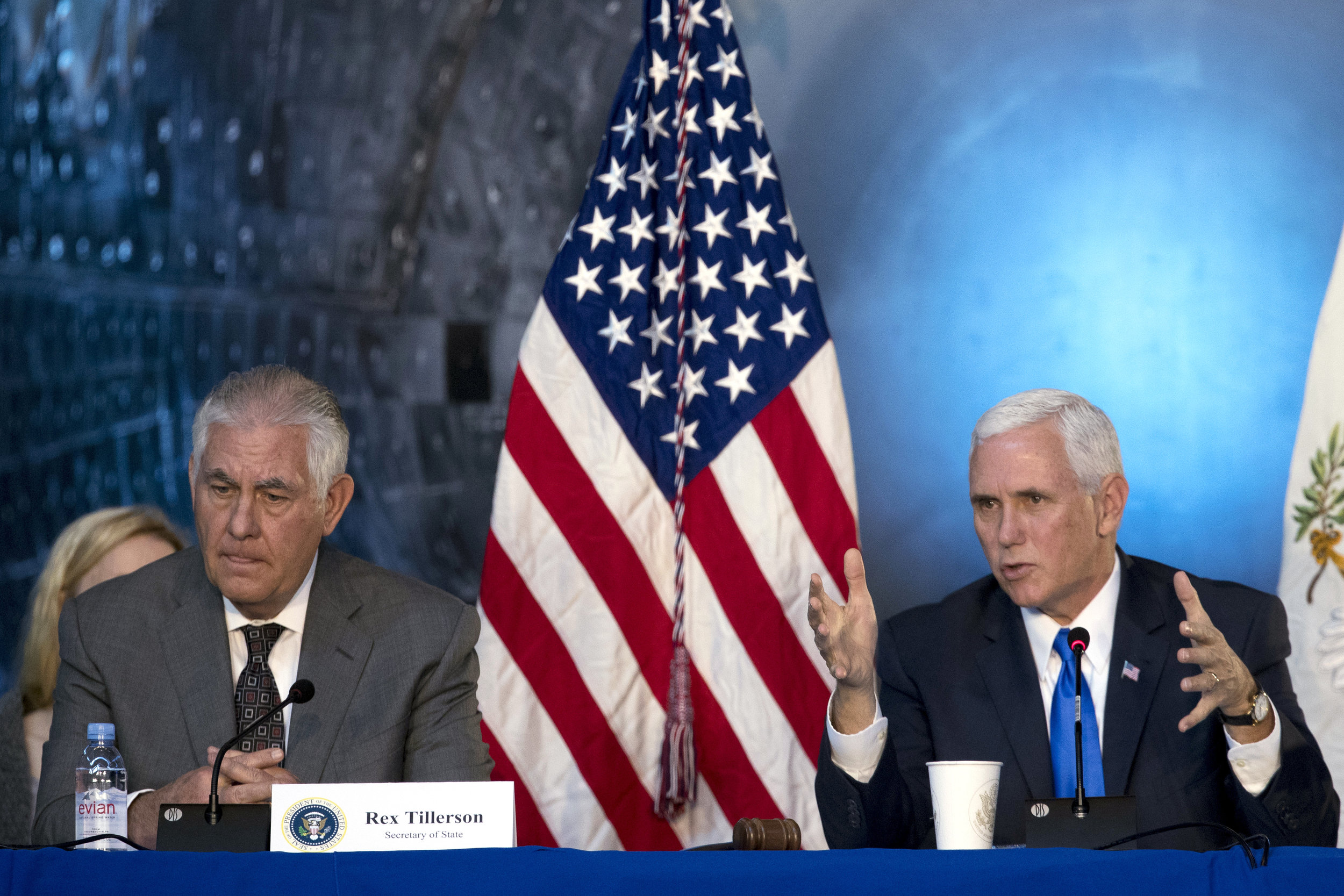 Vice President Mike Pence, right, accompanied by Secretary of State Rex Tillerson, left, speaks during the first meeting of the National Space Council at the Steven F. Udvar-Hazy Center, Thursday, Oct. 5, 2017, in Chantilly, Va. (AP Photo/Andrew Harnik)