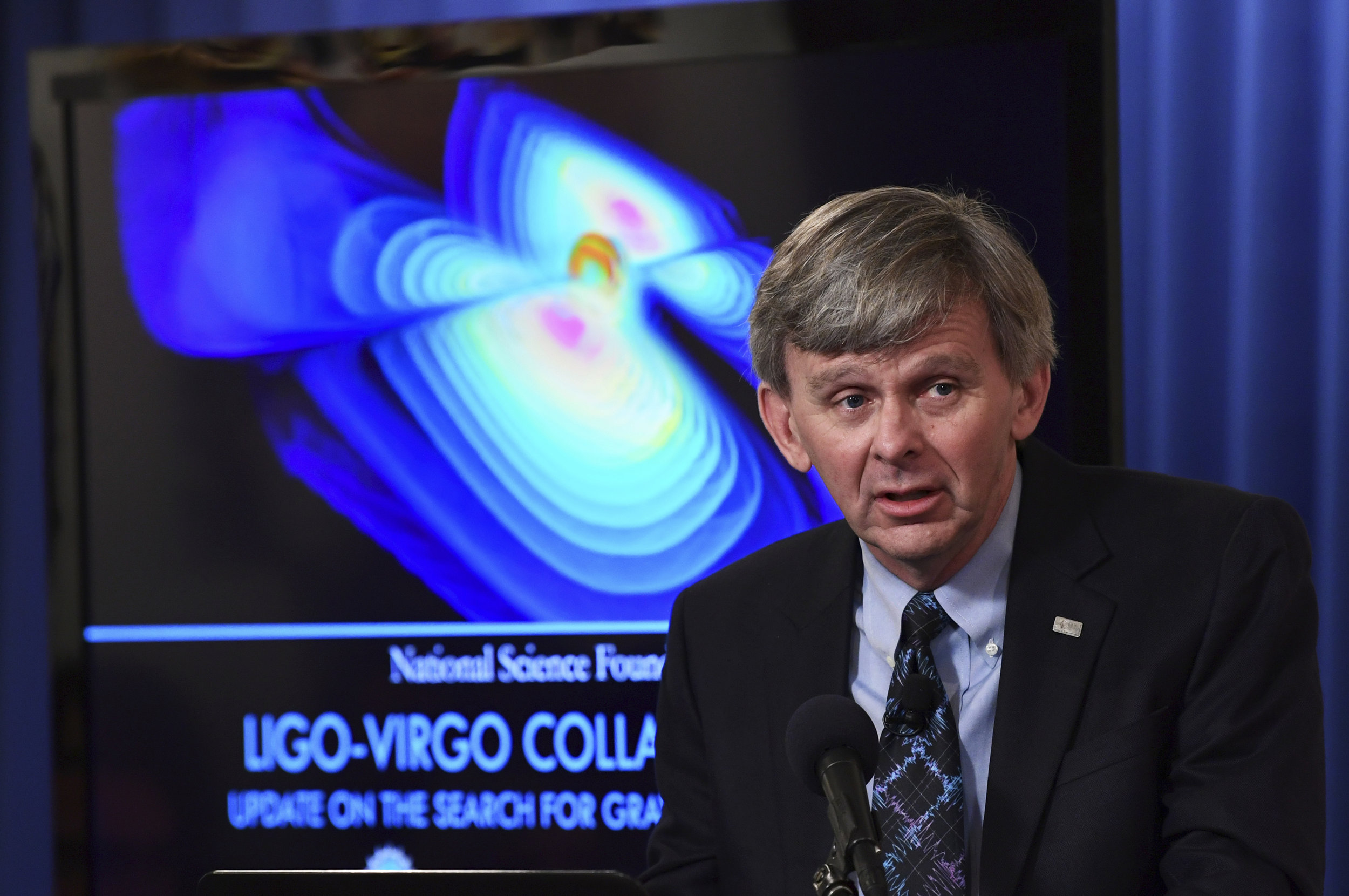 David Reitze of the California Institute of Technology and the executive director of the Laser Interferometer Gravitational-Wave Observatory, or LIGO, speaks at the National Press Club in Washington, Monday, Oct. 16, 2017, during an announcement on one of the most violent events in the cosmos that was witnessed completely for the first time in August and tells scientists where gold and other heavy elements come from. (AP Photo/Susan Walsh)