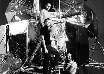 Apollo 14 Astronauts, (F–R) Alan B. Shepard, Jr., Stuart Roosa, and Edgar Mitchell stand on a lunar module mock-up in 1970. Edgar Mitchell told a UK radio that UFOs are real and that governments have been keeping it a secret. (NASA/Getty Images)