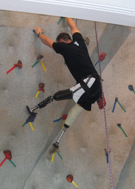 """Iraq vet Keesler gets a new """"foot"""" that locks as needed as he climbs. With two amputations-he still climbs - thanks to VME Founder John Staehlin and Volunteer Lee Mantelmacher."""