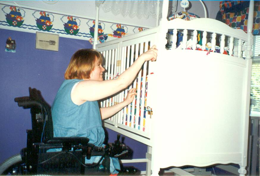 Trish was one of the first to receive an adapted crib from V-LINC. She couldn't roll her w/c under a typical crib and open the side. Now she can with doors that open outward.