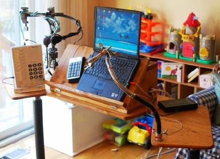 A multi-use desk for phone, computer, mouth stick rest and more for someone who has MS and is paralyzed from the neck down.