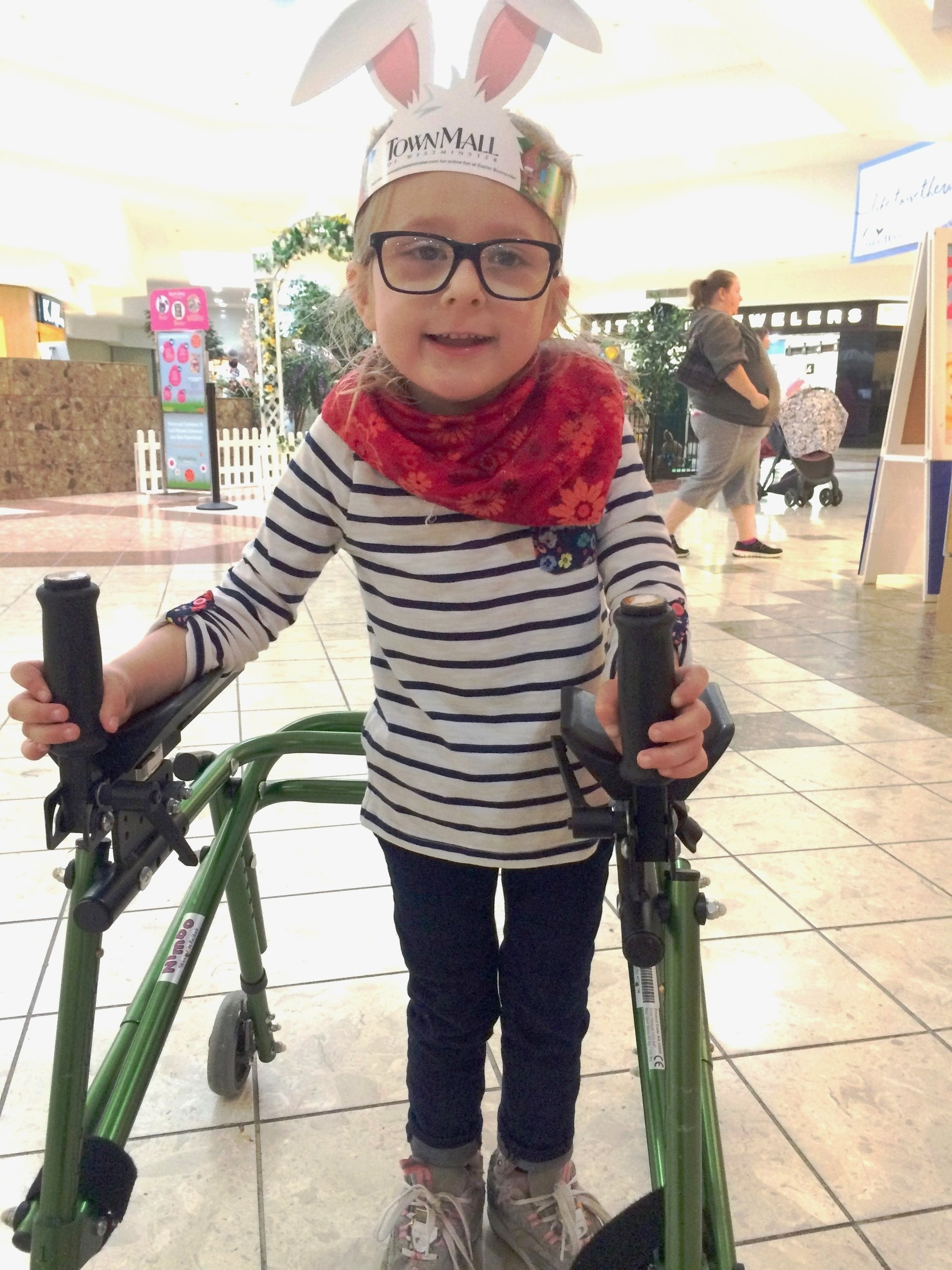 Grace's Story - Help a child like Grace! Grace is a vibrant, determined 5 year-old child who has cerebral palsy (CP) and quadriplegia, which is a great deal to manage at her age. Fortunately, she can stand with the help of a walker, which helps her go where she wants to be. But she had a PROBLEM. The wheels get stuck sometimes and she can't move (think of a shopping cart when the wheels go wrong) - very frustrating! Her parents want her to be as included and free as possible, and so asked V-LINC to modify the walker so Grace can keep moving and manage even a rough surface when she is outside. Her walker's wheels were only able to spin 180 degrees - just enough to get stuck! A V-LINC volunteer found the