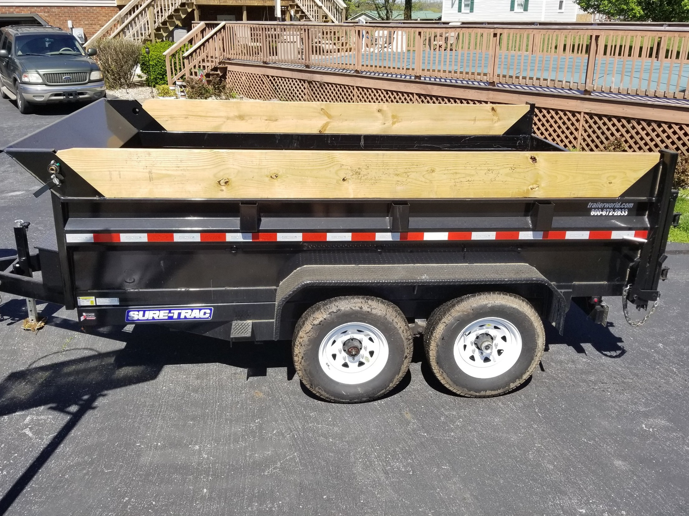 Sur Trac Hydraulic Dump Trailer. Used Twice. Rated to 8,760 lbs. Bed size: 8x12.
