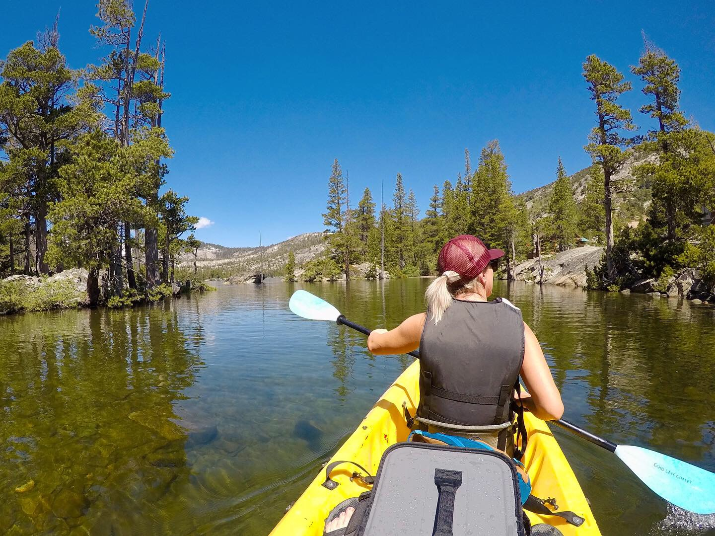 Kayaking through the Upper Echo Lake Channel in Desolation Wilderness in California.