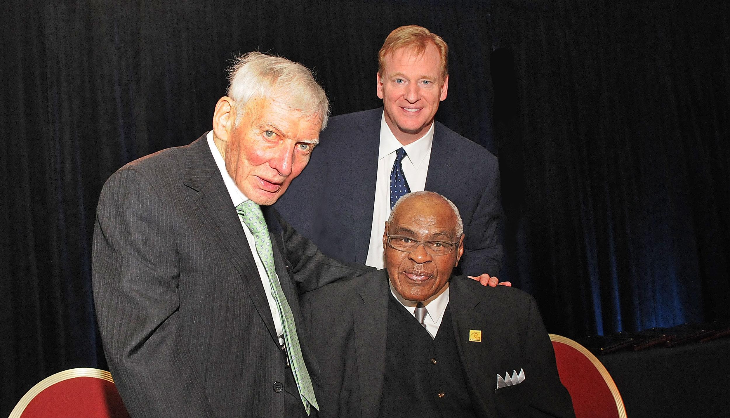 (Left to Right – Dan Rooney, Commissioner Roger Goodell; Seated: John Wooten)